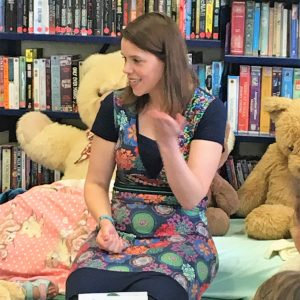 penny holding a library storytime